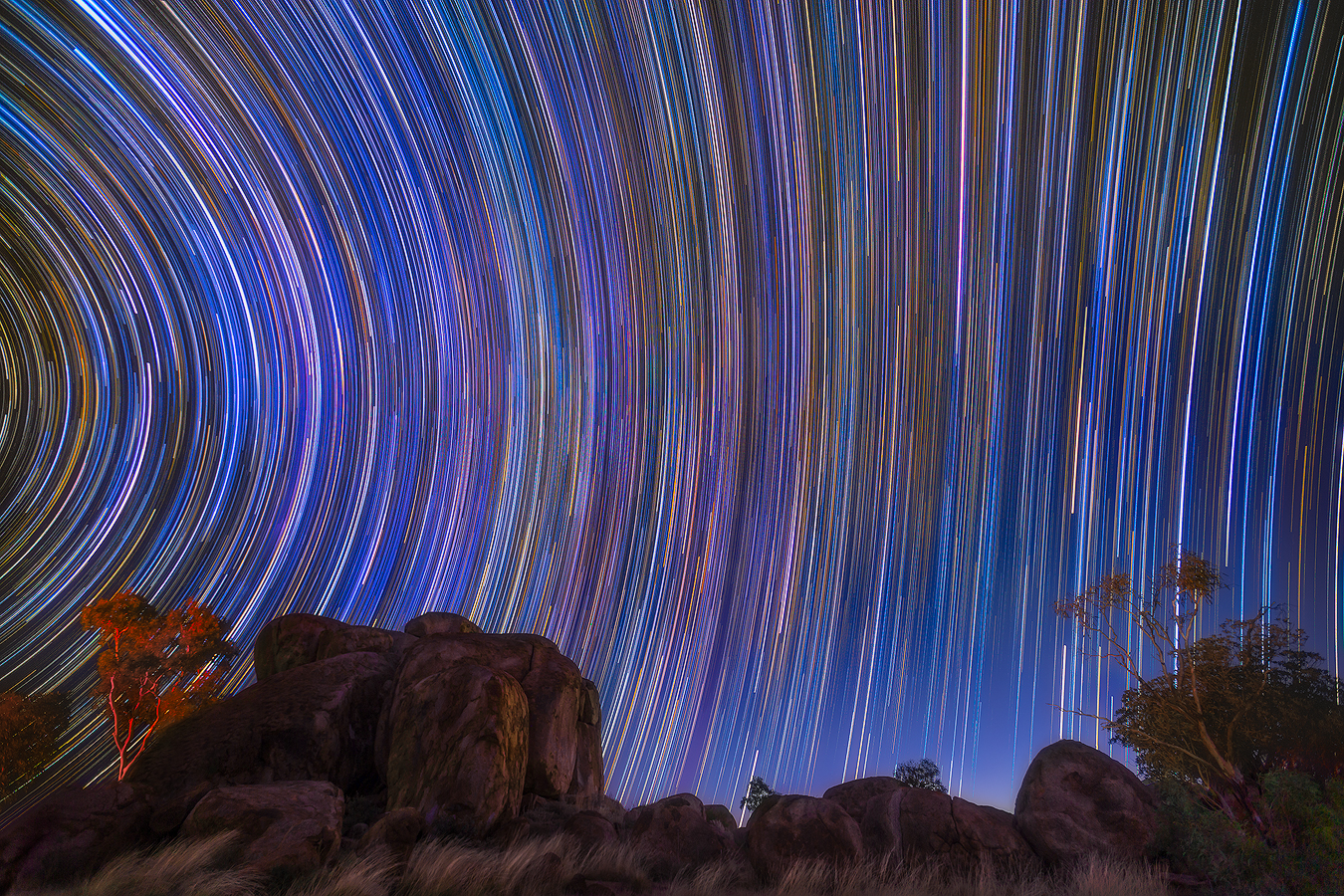 Star Trail - The Devils Dancing at Night at Devils Marbles near Tennant Creek, Australia | We Are Raw Photography Tours
