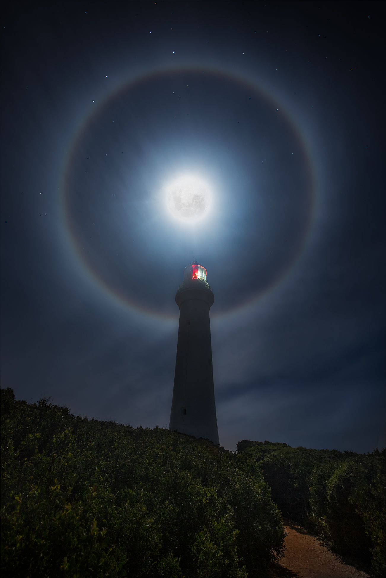 Moon Halo over Aireys Inlet lighthouse on the Great Ocean Road | Night Sky Photography by We Are Raw Photography